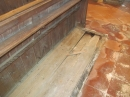 broken flooring in the pew area