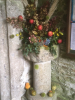 Margaret's beautiful Harvest arrangement in the porch to welcome us all.