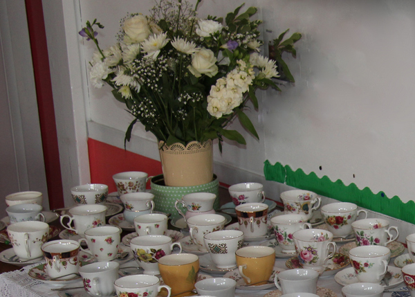 Photo of flowers and cups ready for a celebration