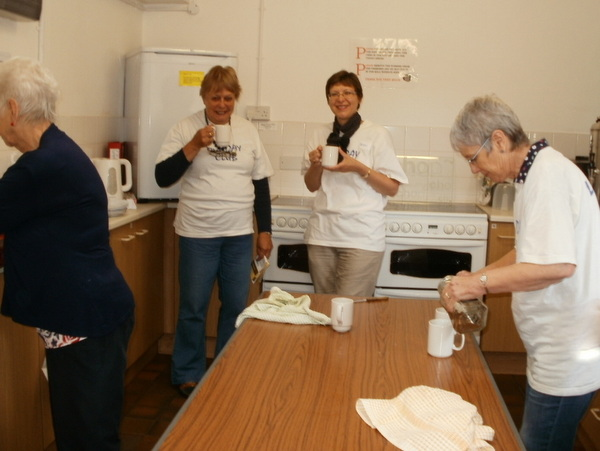 Holiday Club volunteers drink coffee