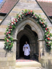 Revd Hannah Suekarran at the door of the church