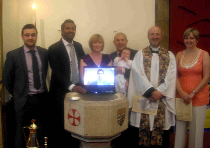 Godparent in Hong Kong joins in live via Skype