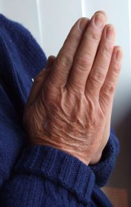 A photo of hands together for prayer