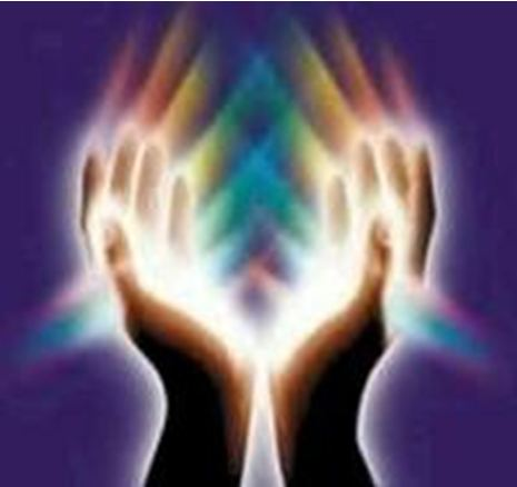 Image of hands held up in prayer, surrounded by lights
