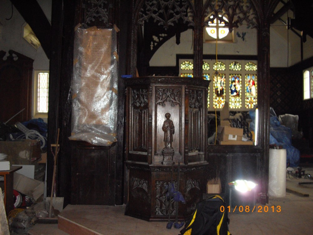 The Pulpit is put back in place
