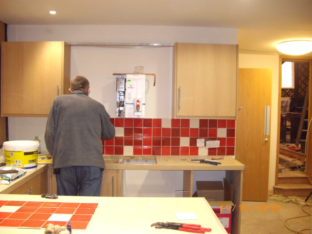 Servery tiles being applied