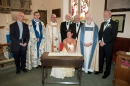 Clergy and the couple with the register
