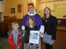Presentation of Father Rob photo album by Youth Group