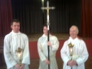 Crucifer and acolytes