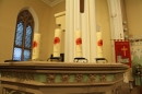 #17 'Lest we forget' candles on the pulpit.