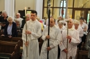 Altar Servers and Choir process down the aisle.