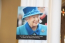 A photo of the Queen on one of the church pillars.