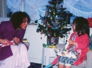 Mum and daughter at Christmas opening presents