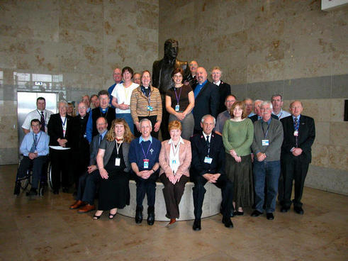 Picture of members of the British Isles and Eire Civil Aviation Chaplains Network taken in Liverpool April 2007 around the statue of John Lennon.