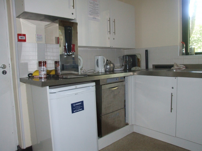 The Kitchen Showing the Fridge and Dishwasher