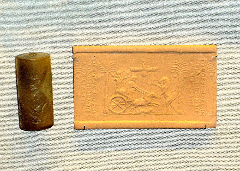 Cylindrical seal with Darius in chariot shooting arrows at a lion (British Museum)