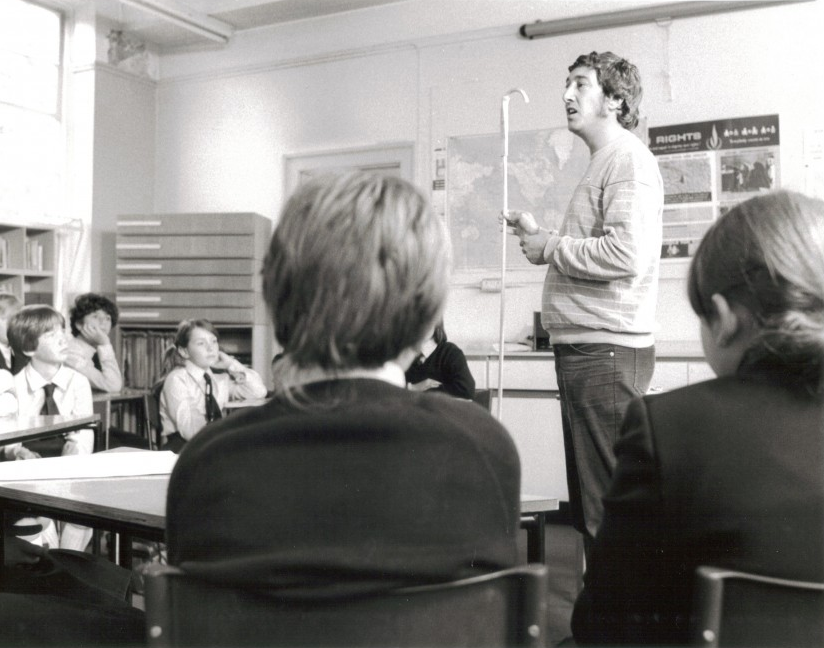"John Flanner MBE, speaking at Malvern Hall School while appearing on Central Television's ""It's a Gift"" programme in 1983."