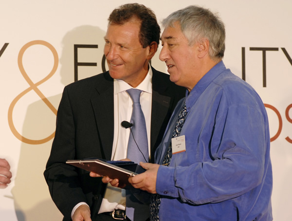 John Flanner MBE receiving the Outstanding Achievement Award at the first National Civil Service Awards ceremony in 2006.  From left to right: Sir Gus O'Donnell and John Flanner MBE.