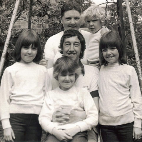 Enjoying the garden with his family in 1983.  Top row from left to right: Sylvia Flanner and Ian Flanner.  Middle row from left to right: Sara Flanner, John Flanner MBE, and Allison Flanner. Front row: Beverley Flanner.
