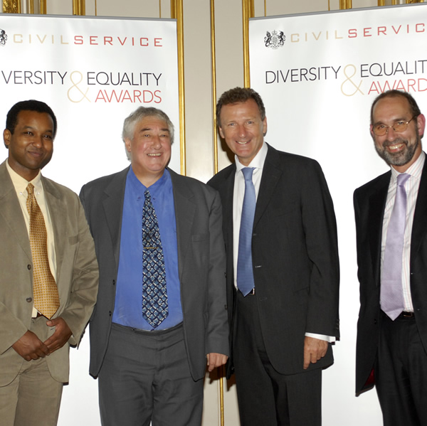 Winning an Award at the National Civil Service Equality and Diversity Awards ceremony in 2006.  From left to right: BBC Reporter Rageh Omaar, John Flanner MBE, Sir Gus O'Donnell, and former HMRC Chairman, Paul Gray.