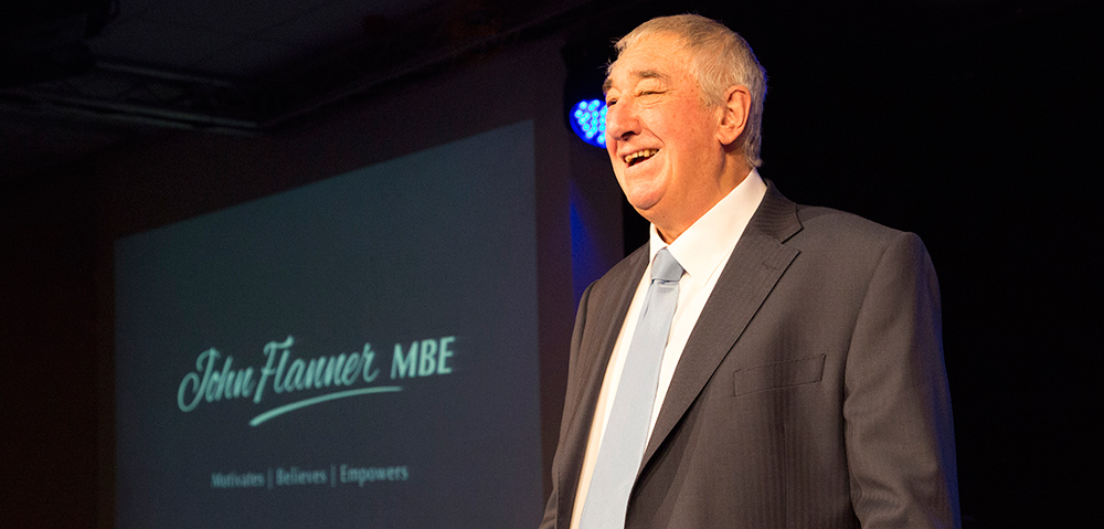 John Flanner MBE on stage photo