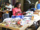 Members of Fancy Stitch working on her beading