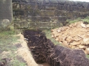 Trench through boundary wall