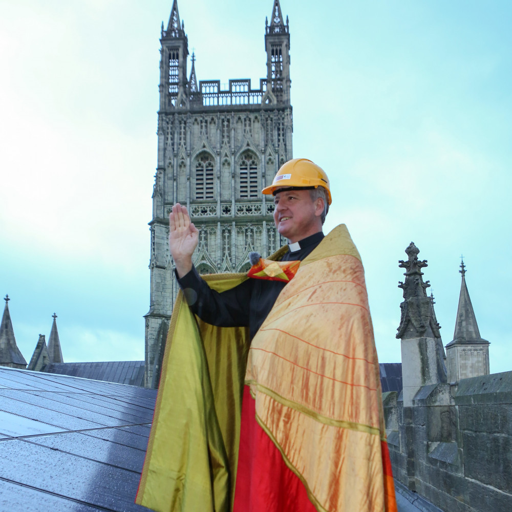 The Dean blessing the new solar panels on the Gloucester Cathedral nave roof, installed in 2016 with £56,000 contribution from FOGC