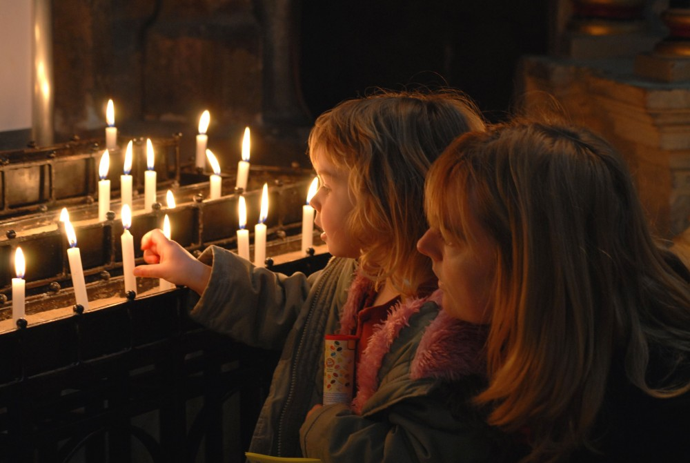 Image of girls lighting candles