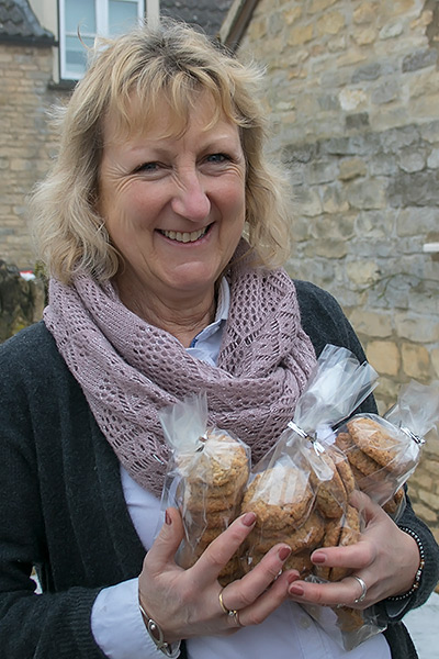 Cathy Dyson holding some biscuits bound for prison