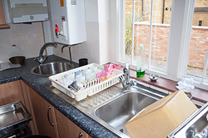 View of shining stainless steel kitchen sink