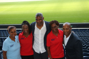 Members of Cyrille's family with Les Ferdinand (far right).