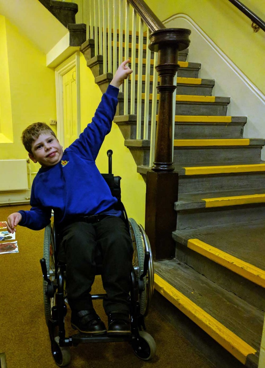 Nathan pointing at the narrow Regent Room staircase