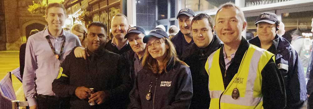 The Street Pastors with the Deputy Mayour outside Lawrence Sheriff school