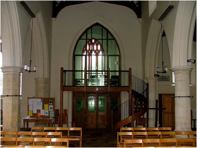 Chapel built into former bellringing chamber, with elegant sprial staircase up to it.