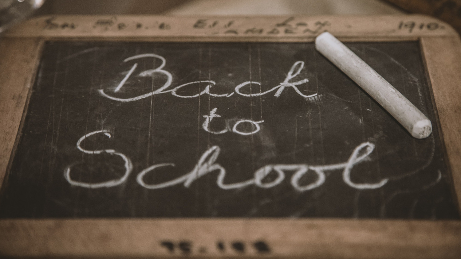 Image of chalkboard with the words 'back to school' in chalk