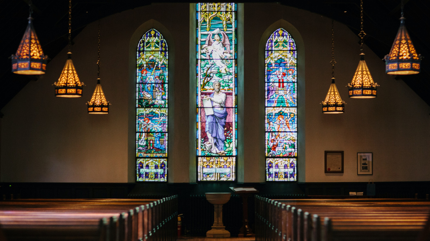Image of stained glass windows within a church