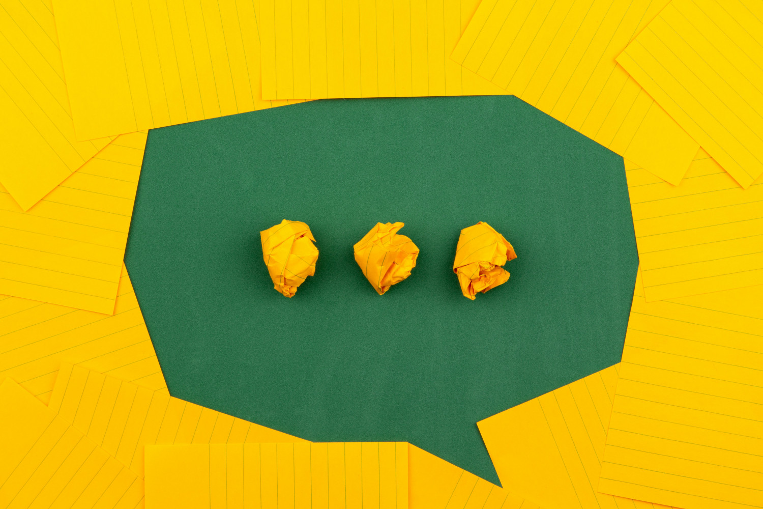 Image of a speech bubble made up up of origami