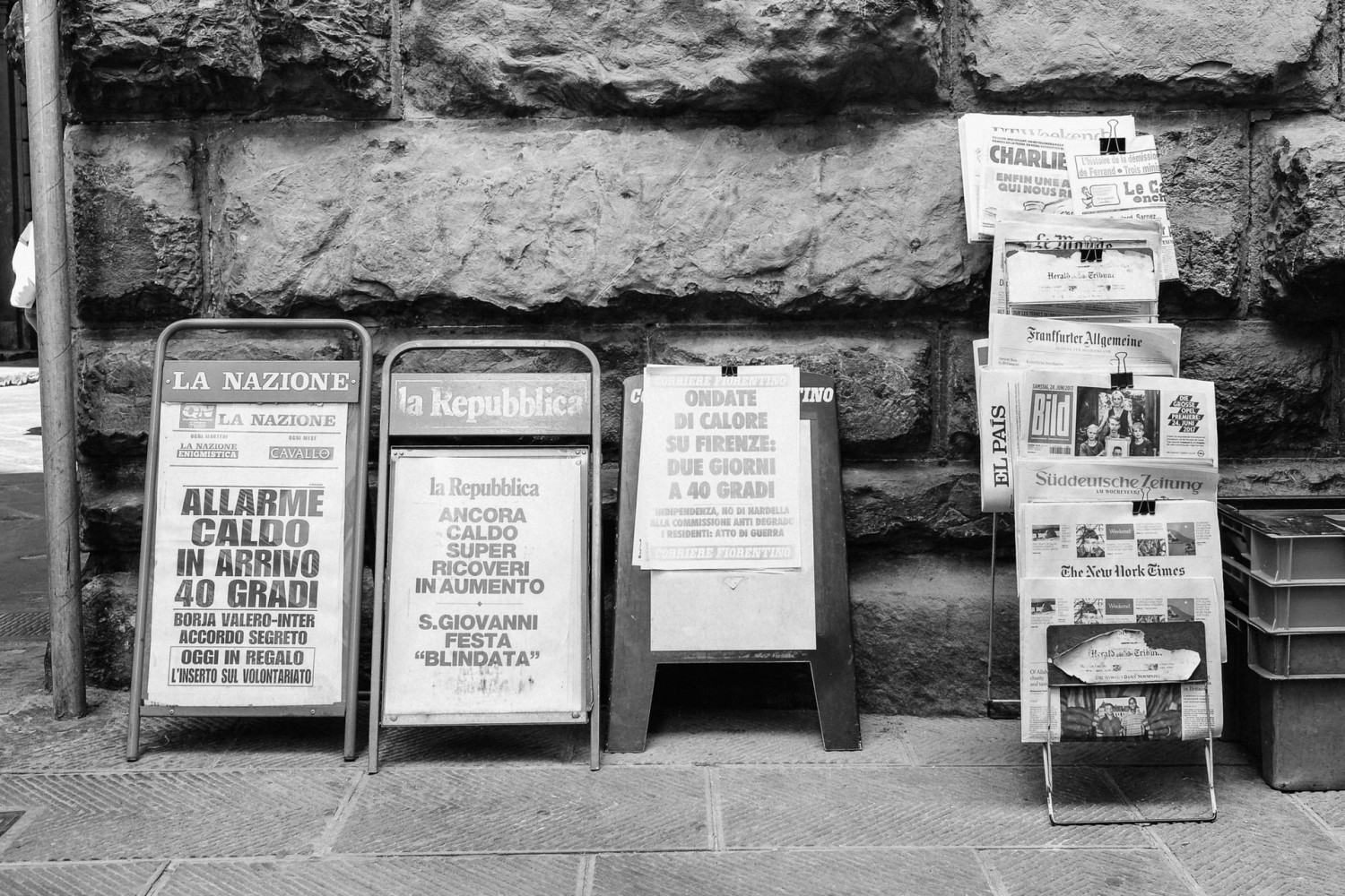Image of various news stands on a pavement