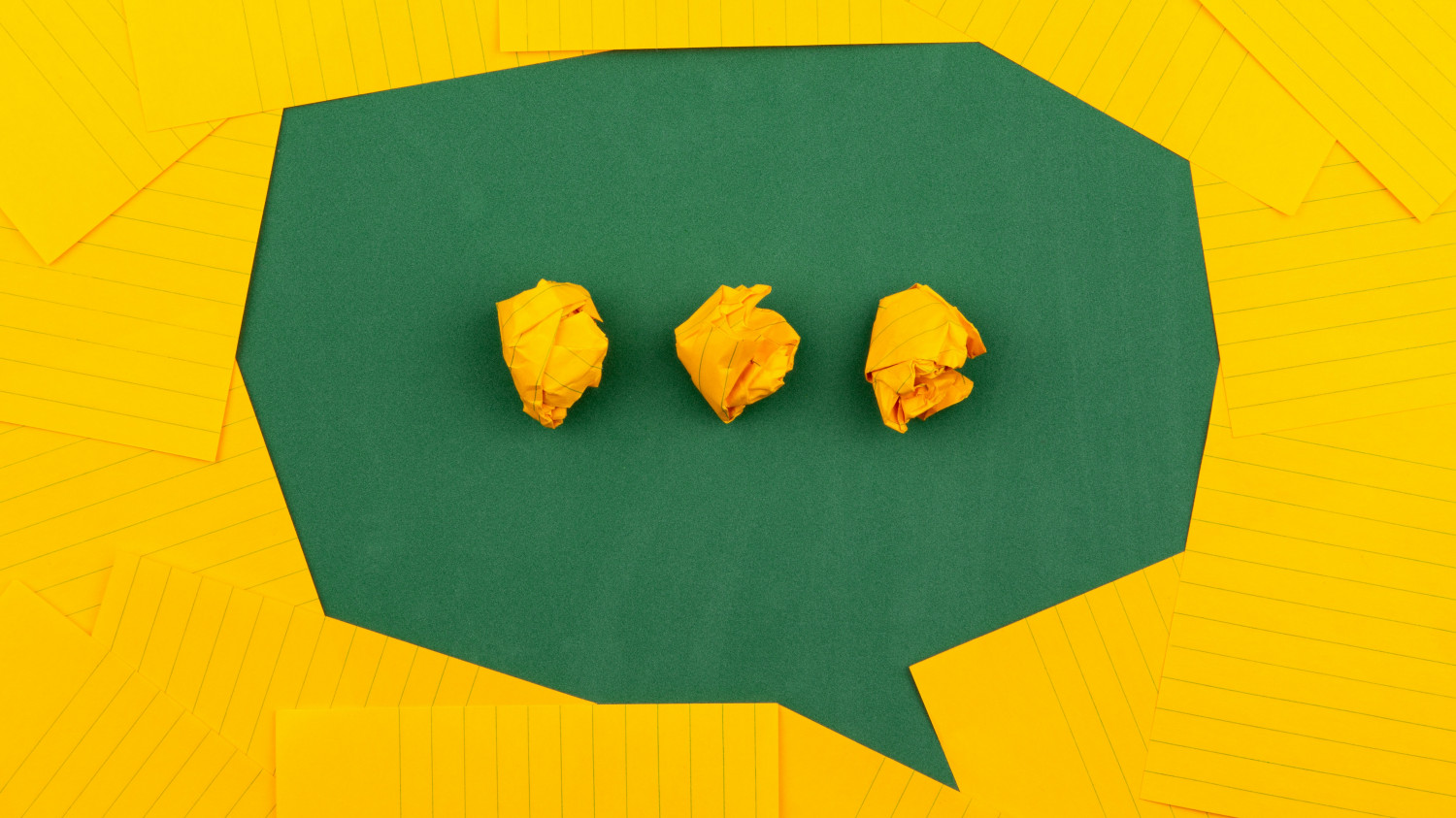 Image of a speech bubble made up of origami
