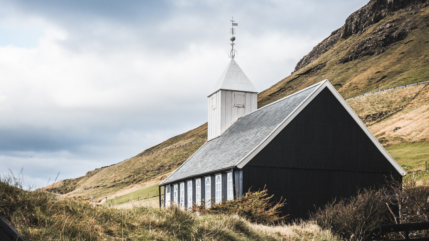 Image of a single storey church on a hillside