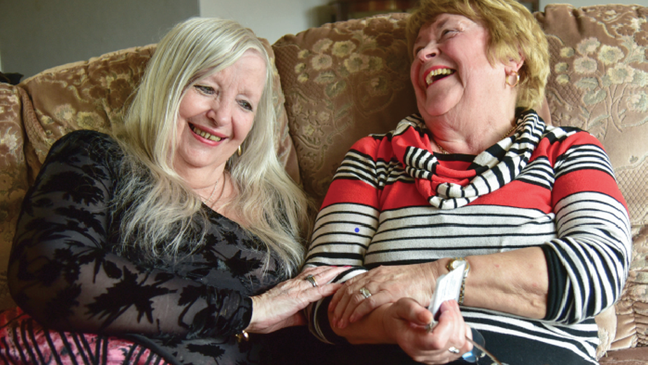 Elizabeth Gervais-Golland (left) shares happy memories with Co Co volunteer Nancy Hemmings (right)