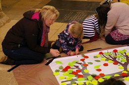Adult and child creating tree artwork